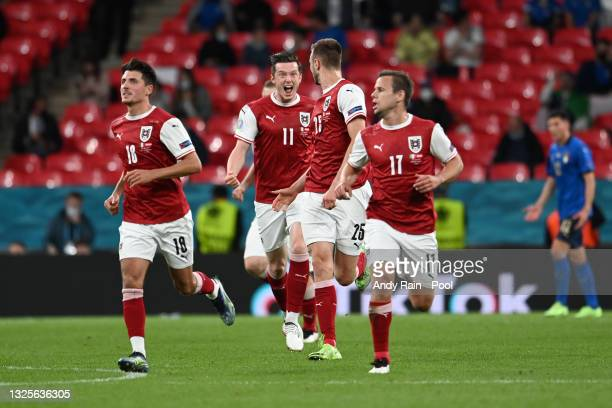 Sasa Kalajdzic of Austria celebrates with Michael Gregoritsch after scoring their side's first goal during the UEFA Euro 2020 Championship Round of...