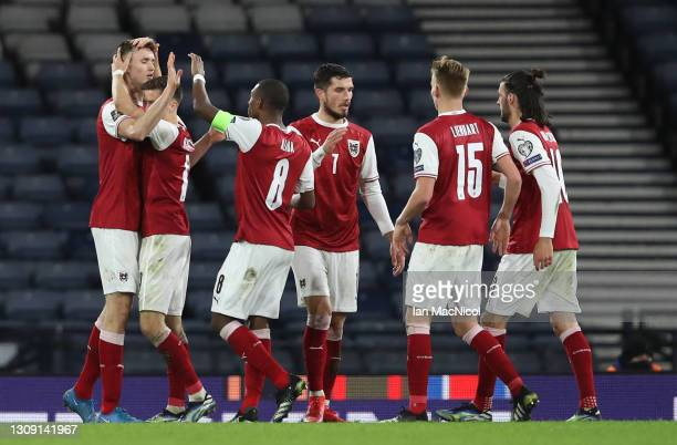 Sasa Kalajdzic of Austria celebrates with team mates after scoring their side's first goal during the FIFA World Cup 2022 Qatar qualifying match...