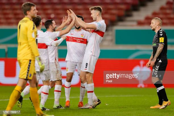 Sasa Kalajdzic of VfB Stuttgart celebrates with his team mates after scoring their sides first goal during the DFB Cup second round match between VfB...