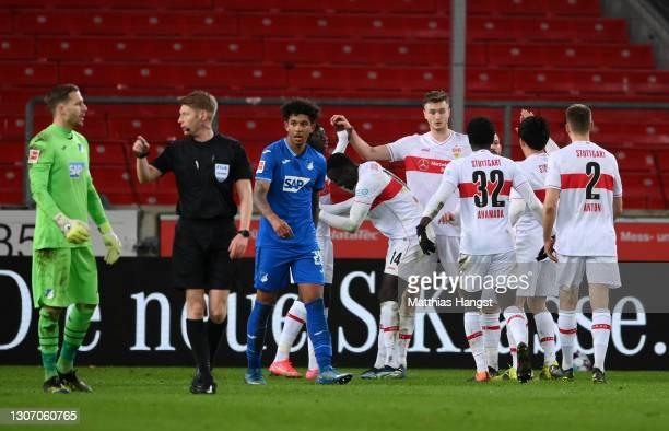 Sasa Kalajdzic of VfB Stuttgart celebrates with team mates after scoring their side's second goal during the Bundesliga match between VfB Stuttgart...