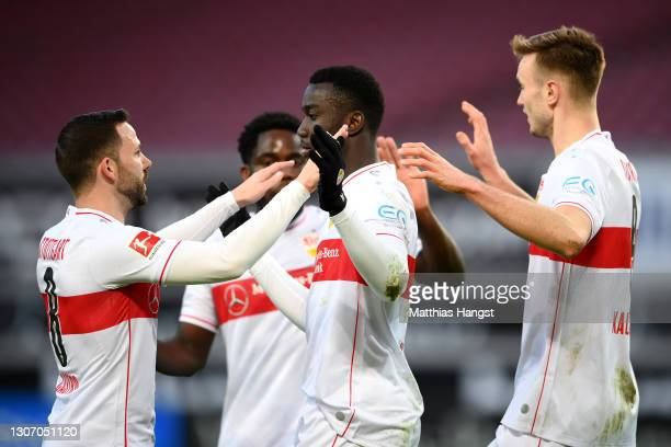 Sasa Kalajdzic of VfB Stuttgart celebrates with team mates Silas Wamangituka and Gonzalo Castro after their side's first goal, an own goal scored by...