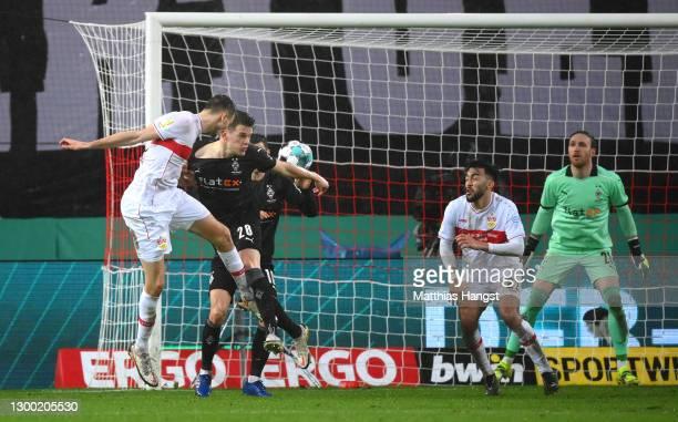 Sasa Kalajdzic of VfB Stuttgart shoots a header past Matthias Ginter of Borussia Monchengladbach during the DFB Cup Round of Sixteen match between...