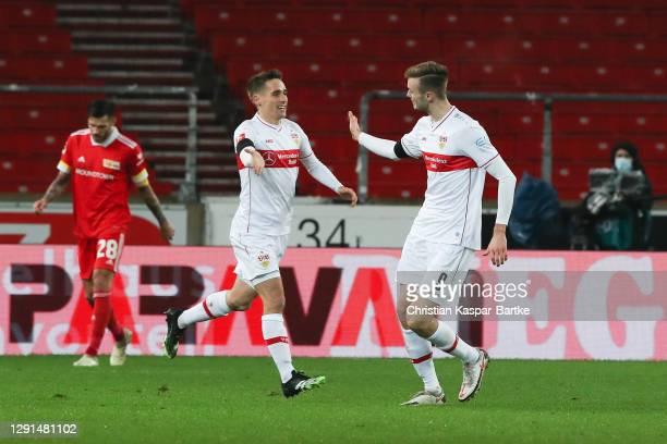 Sasa Kalajdziz of VfB Stuttgart celebrates with teammate Waldemar Anton after scoring their team's first goal during the Bundesliga match between VfB...