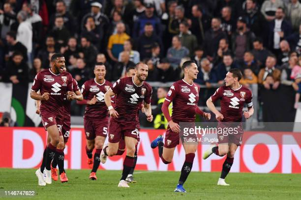 Sasa Lukic of Torino celebrates with team mates after scoring the opening goal during the Serie A match between Juventus and Torino FC on May 03,...