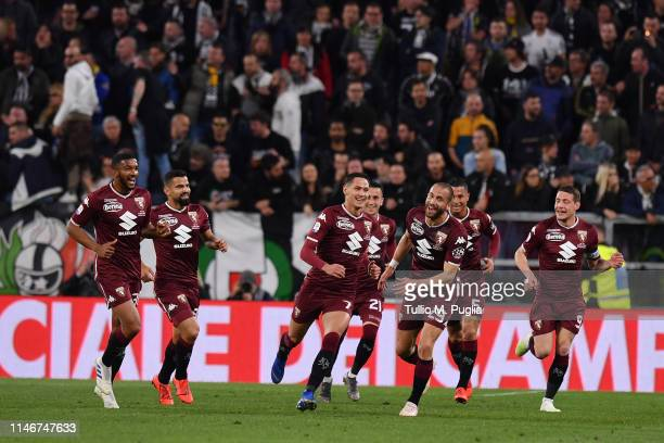 Sasa Lukic of Torino celebrates with team mates after scoring the opening goal during the Serie A match between Juventus and Torino FC on May 03 2019...