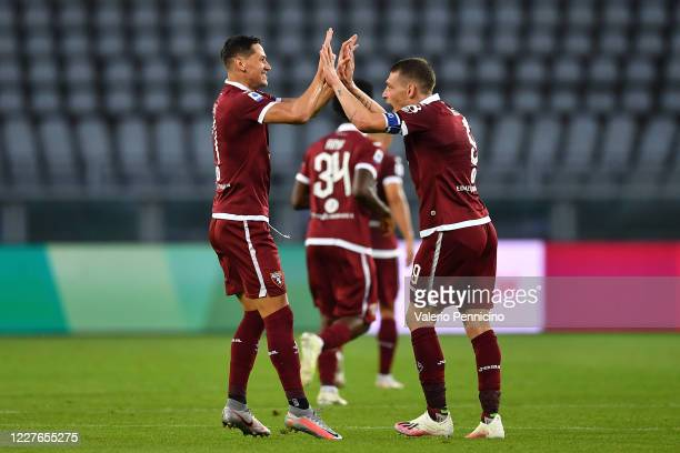Sasa Lukic of Torino FC celebrates a goal with team mate Andrea Belotti during the Serie A match between Torino FC and Genoa CFC at Stadio Olimpico...
