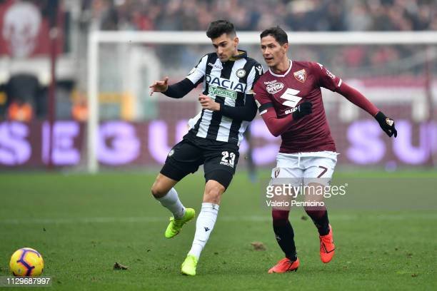 Sasa Lukic of Torino FC is challenged by Ignacio Pussetto of Udinese during the Serie A match between Torino FC and Udinese at Stadio Olimpico di...