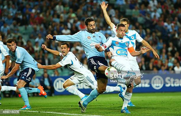 Sasa Ognenovski of Sydney and Leigh Broxham of the Victory contest possession during the round six ALeague match between Sydney FC and Melbourne...