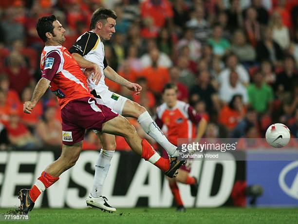 Sasa Ognenovski of the Roar contests the ball with Shane Smeltz of the Phoenix during the round seven A-League match between the Queensland Roar and...