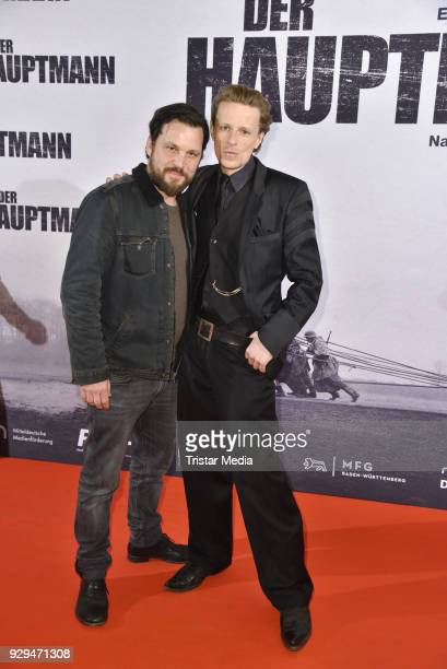 Sascha Alexander Gersak and Alexander Scheer attend the premiere of 'Der Hauptmann' at Kino International on March 8 2018 in Berlin Germany