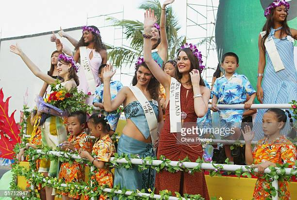 Sascha Andrew-Rose of St. Lucia , Veronica Roberts of Chile , Kirsty Anne Gabriel Stewart of Northern Ireland waves during a promotional parade of...