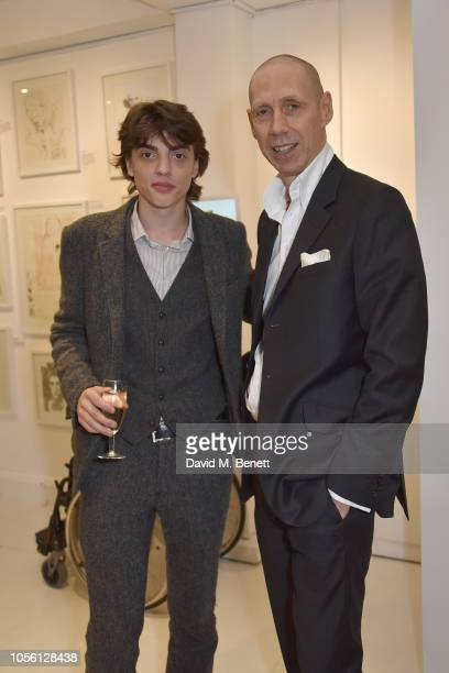 Sascha Bailey and Nick Knight attend a private view of '100 Women' an exhibition of fashion illustration to celebrate the centenary of women's...
