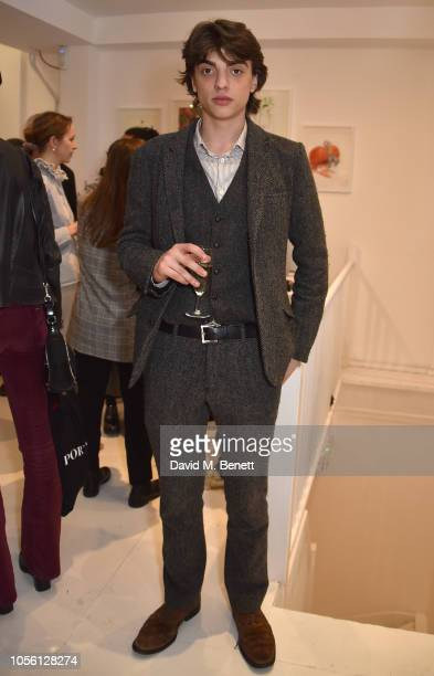 Sascha Bailey attends a private view of '100 Women' an exhibition of fashion illustration to celebrate the centenary of women's suffrage at...