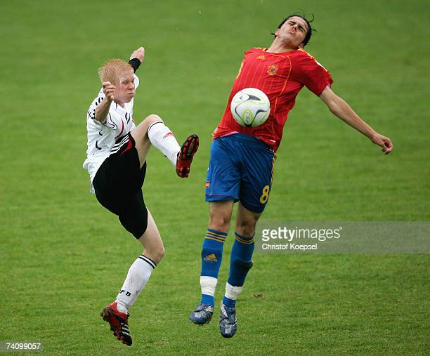 Sascha Bigalke of Germany is tackled by David Gonzalez Diaz of Spain during the 2007 UEFA European Under 17 Championship group A match between Spain...