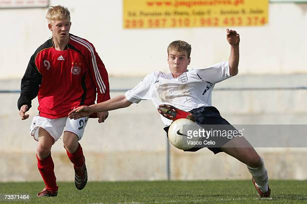 Sascha Bigalke of Germany vies for the ball with Liam Darville of England during the Men's U17 international Tournament match between Englad and...