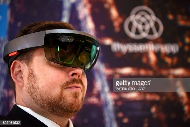 Sascha Froemming from Thyssenkrupp elevators looks through a hololens egineered by German steel group Thyssenkrupp on the sidelines of a press...