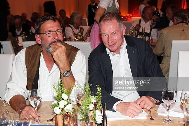 Sascha Hehn and Stefan Reuter attend the Camp Beckenbauer After Golf Party at Hotel Stanglwirt on September 3 2014 in Going near Kitzbuehel Austria