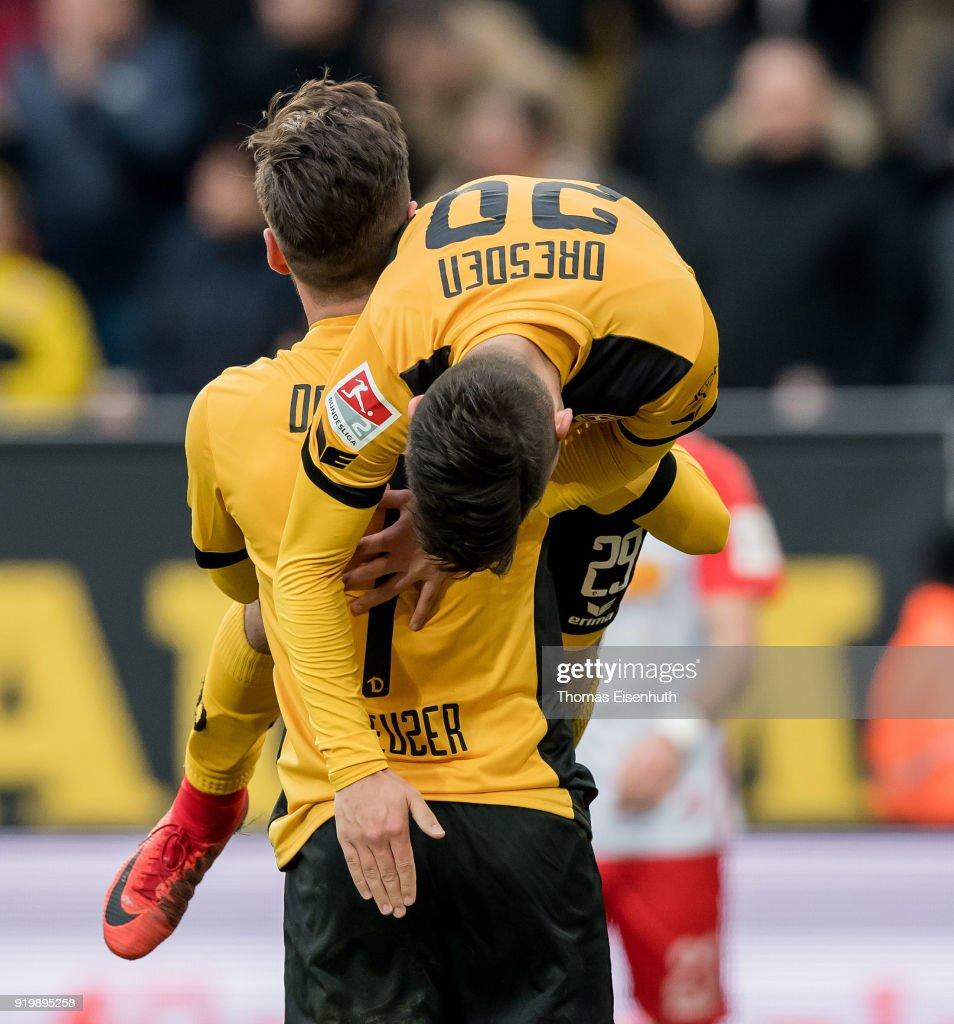 Sascha Horvath (R) and Niklas Kreuzer of Dresden celebrate after the Second Bundesliga match between SG Dynamo Dresden and SSV Jahn Regensburg at DDV-Stadion on February 18, 2018 in Dresden, Germany.