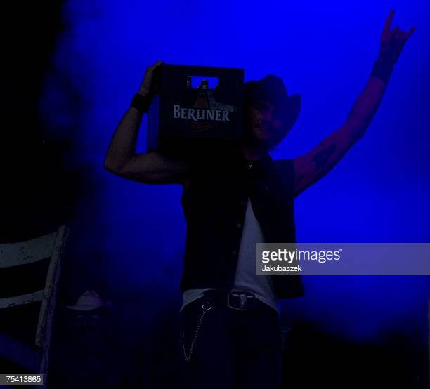 Sascha 'Hoss Powers' Vollmer of the German band The BossHoss performs during a concert at the Zitadelle Spandau July 14 2007 in Berlin Germany The...