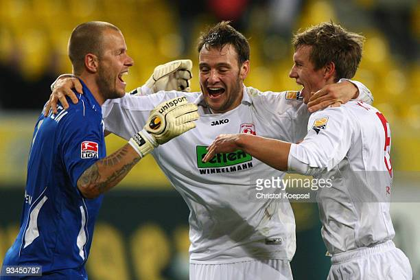 Sascha Kirschstein Nils Doering and Ole Kittner of Ahlen celebrate the 20 victory after the second Bundesliga match between Alemannia Aachen and Rot...