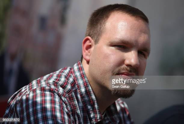 Sascha Krolzig of the farright fringe political party Die Rechte attends a press conference at the venue of a neoNazi music fest on April 21 2018 in...