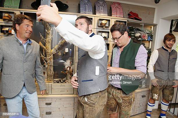 Sascha Mölders of TSV 1860 makes selfies during the TSV 1860 team fitting at the Angermeier store on September 7 2016 in Munich Germany