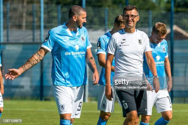 Sascha Mölders talks to headcoach Michael Köllner of TSV 1860 Muenchen during the team presentation on August 19, 2020 in Munich, Germany.