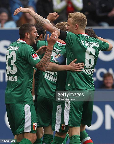 Sascha Moelders Kevin Vogt and temmates of Augsburg celebrate their first goal during the Bundesliga match between FC Augsburg and Hamburger SV at...