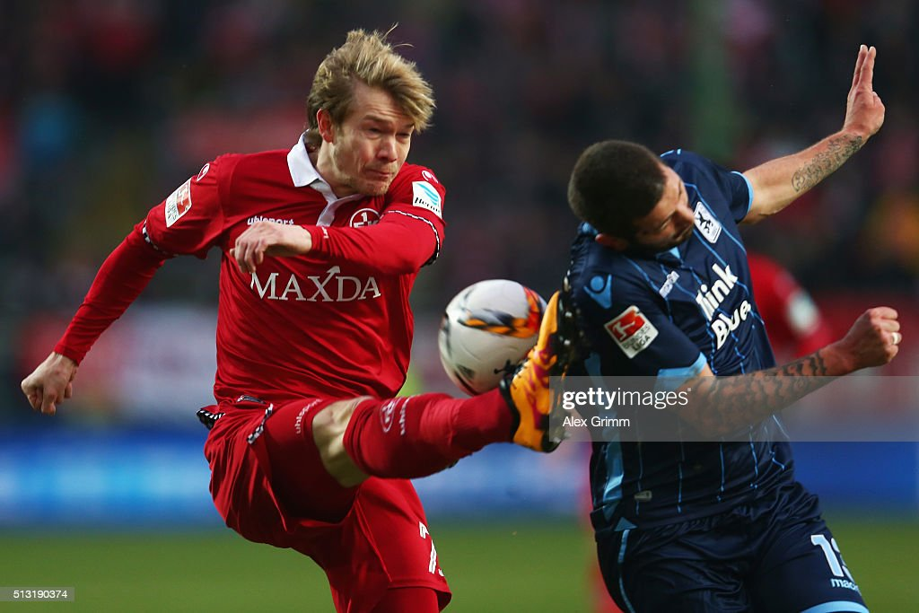 Sascha Moelders (R) of 1860 Muenchen is challenged by Michael Schulze of Kaiserslautern during the Second Bundesliga match between 1. FC Kaiserslautern and TSV 1860 Muenchen at Fritz-Walter-Stadion on March 1, 2016 in Kaiserslautern, Germany.