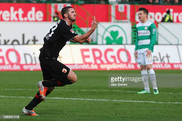 Sascha Moelders of Augsburg celebrates his team's first goal as Zoltan Stieber of Greuther Fuerth reacts during the Bundesliga match between SpVgg...