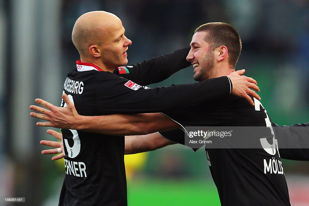 Sascha Moelders (R) of Augsburg celebrates his team's first goal with team mate Tobias Werner during the Bundesliga match between SpVgg Greuther Fuerth and FC Augsburg at Trolli-Arena on December 15, 2012 in Fuerth, Germany.