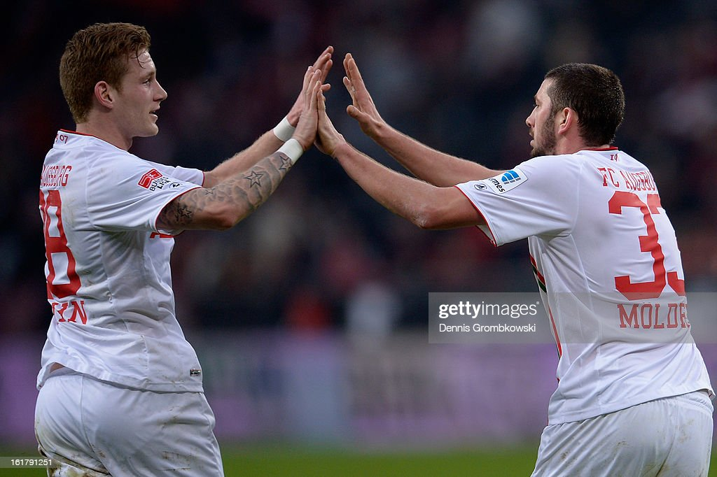 Sascha Moelders of Augsburg celebrates with teammate Andre Hahn after scoring his team's first goal during the Bundesliga match between Bayer 04 Leverkusen and FC Augsburg at BayArena on February 16, 2013 in Leverkusen, Germany.