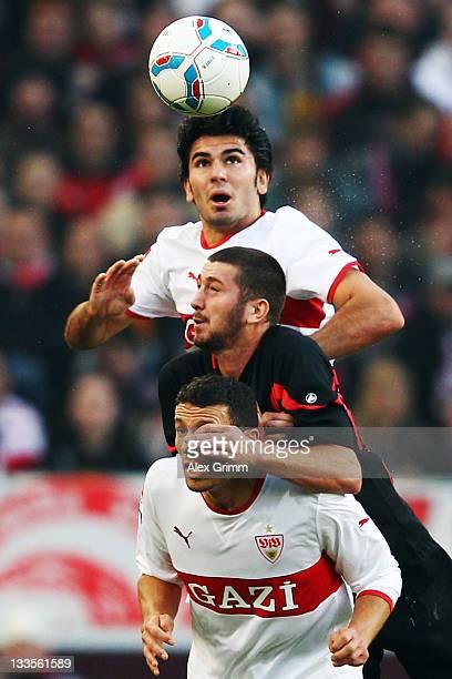 Sascha Moelders of Augsburg jumps for a header with Khalid Boulahrouz and Serdar Tasci of Stuttgart during the Bundesliga match between VfB Stuttgart...