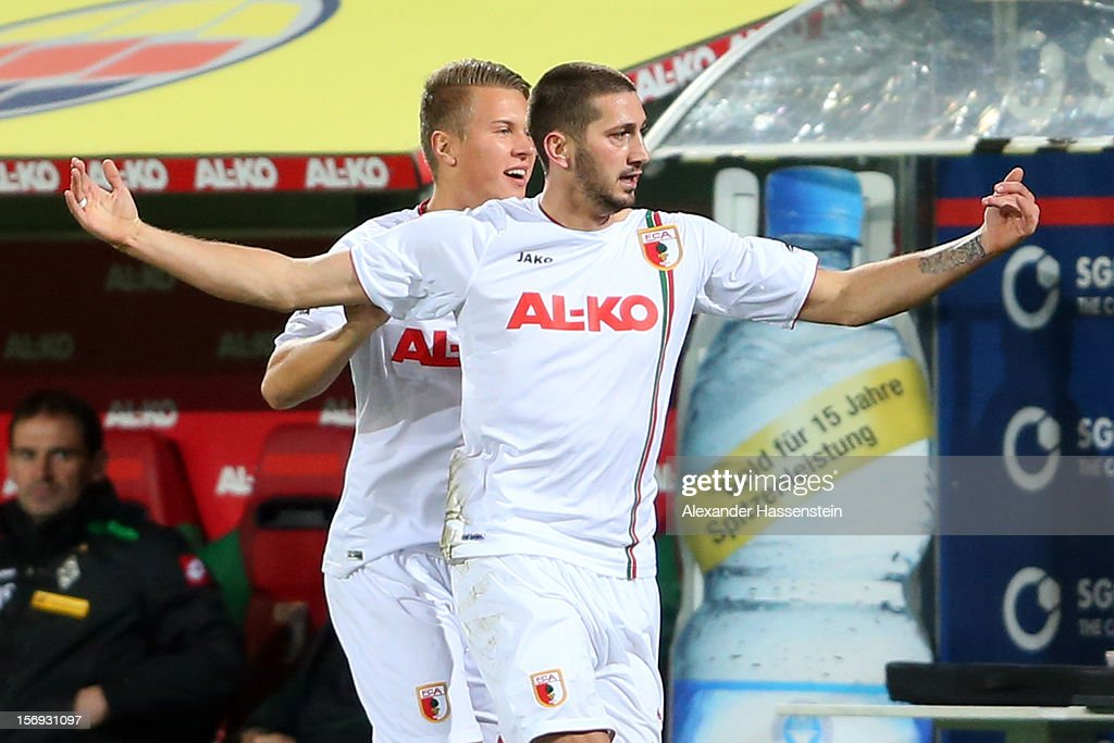 Sascha Moelders (R) of Ausgbsurg celebrates scoring the opening goal with his team mate Matthias Ostrzolek (L) during the Bundesliga match between FC Augsburg and VfL Borussia Moenchengladbach at SGL Arena on November 25, 2012 in Augsburg, Germany.