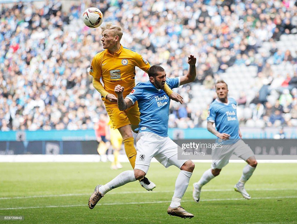 Sascha Molders of TSV 1860 Munich is challenged by Saulo Decarli of Eintracht Braunschweig during the 2. Bundesliga match between 1860 Muenchen and Eintracht Braunschweig at Allianz Arena on April 24, 2016 in Munich, Germany.