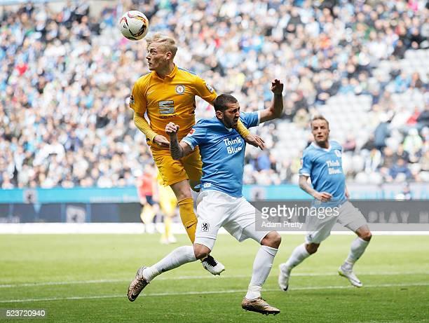 Sascha Molders of TSV 1860 Munich is challenged by Saulo Decarli of Eintracht Braunschweig during the 2 Bundesliga match between 1860 Muenchen and...