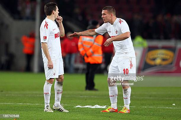 Sascha Riether and Lukas Podolski of Koeln discuss after the Bundesliga match between 1. FC Koeln and FSV Mainz 05 at RheinEnergieStadion on December...