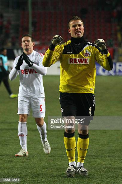 Sascha Riether and Michael Rensing of Koeln celebrate after the Bundesliga match between 1. FC Kaiserslautern and 1. FC Koeln at Fritz-Walter-Stadium...