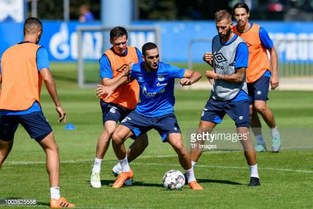 Sascha Riether of Schalke Nabil Bentaleb of Schalke and Guido Burgstaller of Schalke battle for the ball during a training session at the FC Schalke...