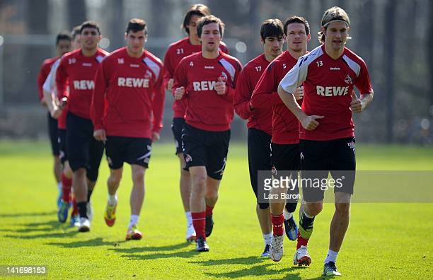 Sascha Riether warms up with team mates during a 1. FC Koeln training session at Geissbockheim on March 22, 2012 in Cologne, Germany.