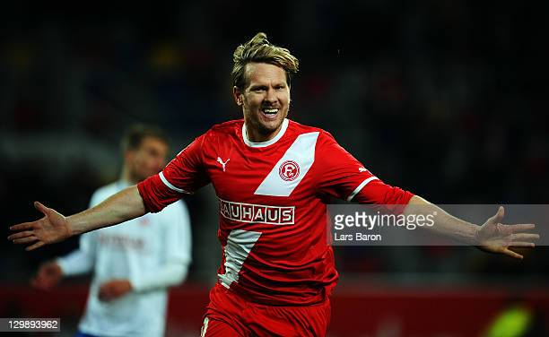 Sascha Roesler of Duesseldorf celebrates after scoring his teams second goal during the Second Bundesliga match between Fortuna Duesseldorf and Hansa...