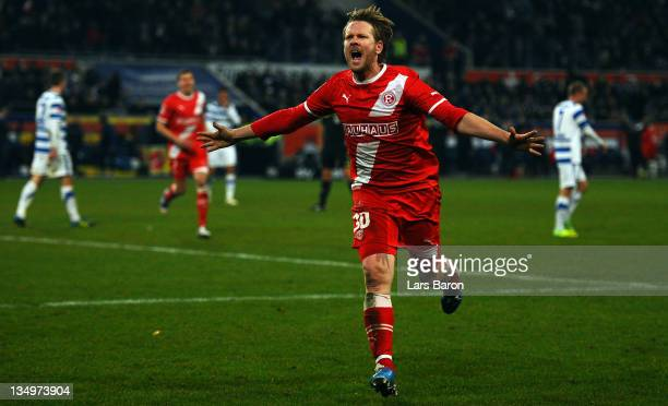 Sascha Roesler of Duesseldorf celebrates after scoring his teams second goal during the Second Bundesliga match between MSV Duisburg and Fortuna...