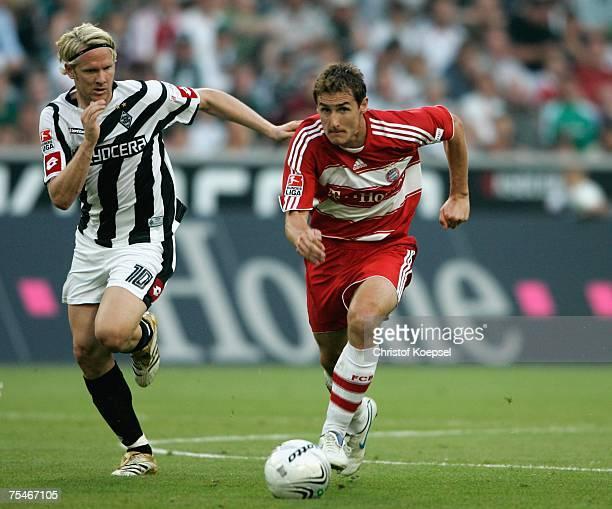 Sascha Roesler of Moenchengladbach follows Miroslav Klose of Bayern during the friendly match between Borussia Moenchengladbach and Bayern Munich at...