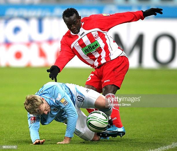 Sascha Roesler of Muenchen battles for the ball with Momar N'Diaye of Ahlen during the Second Bundesliga match between 1860 Muenchen and Rot Weiss...