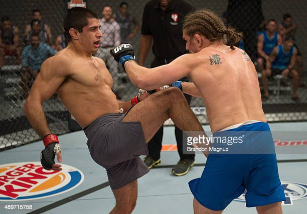 Sascha Sharma knees Chris Gruetzemacher during the filming of The Ultimate Fighter: Team McGregor vs Team Faber at the UFC TUF Gym on July 27, 2015...