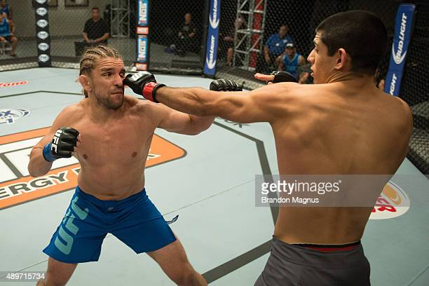 Sascha Sharma punches Chris Gruetzemacher during the filming of The Ultimate Fighter: Team McGregor vs Team Faber at the UFC TUF Gym on July 27, 2015...