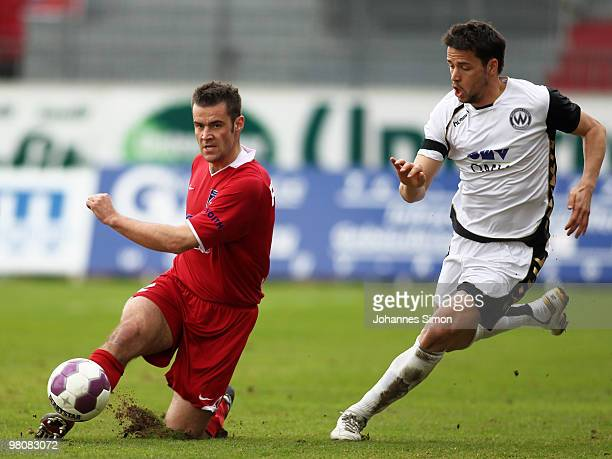 Sascha Traut of Burghausen battles for the ball with Ingo Feistle of Heidenheim during the third division match between Wacker Burghausen and 1. FC...