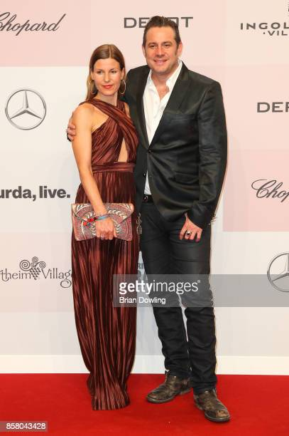 Sascha Vollmer and girlfriend Jenny arrive at Tribute To Bambi at Berlin Station on October 5 2017 in Berlin Germany
