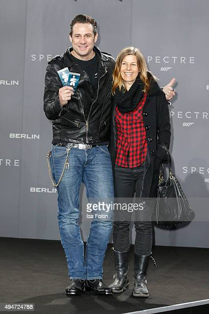 Sascha Vollmer and guest attend the 'Spectre' German Premiere on October 28 2015 in Berlin Germany