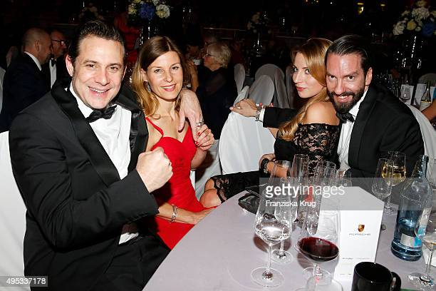 Sascha Vollmer and guest Johanna Michels and Alec Voelkel attend the Leipzig Opera Ball 2015 on October 31 2015 in Leipzig Germany